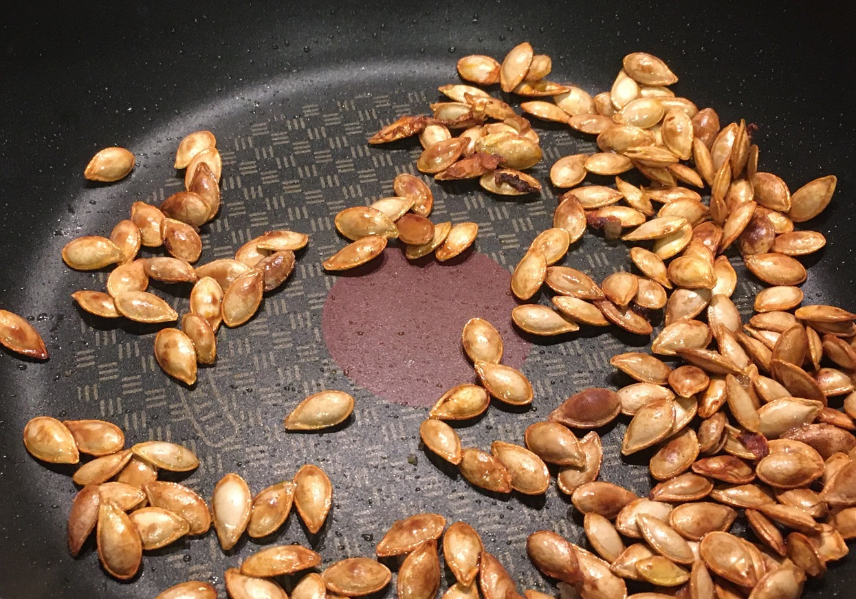 Butternut squash seeds on a pan, golden and cooked