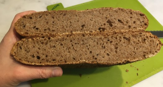 Wholemeal spelt loaf cut in two