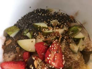 Porridge with EVERYTHING: pear, strawberries, peanut butter, chia seeds, coconut and dukkah