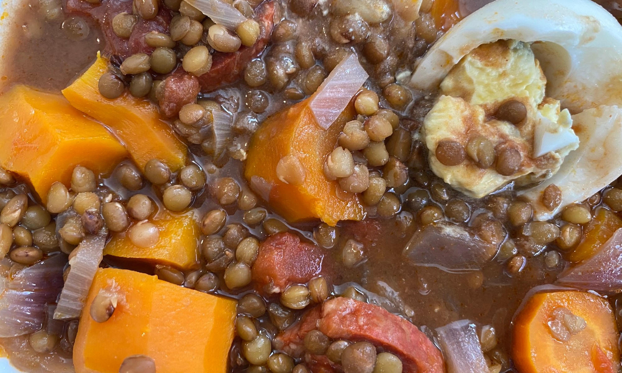 Close up of lentejas served in a dish (lentil stew)