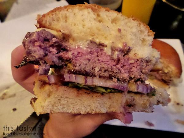 Cross section of the Harris Ranch Beef Burger at South Park Abbey | San Diego Burger Week 2016 | This Tasty Life