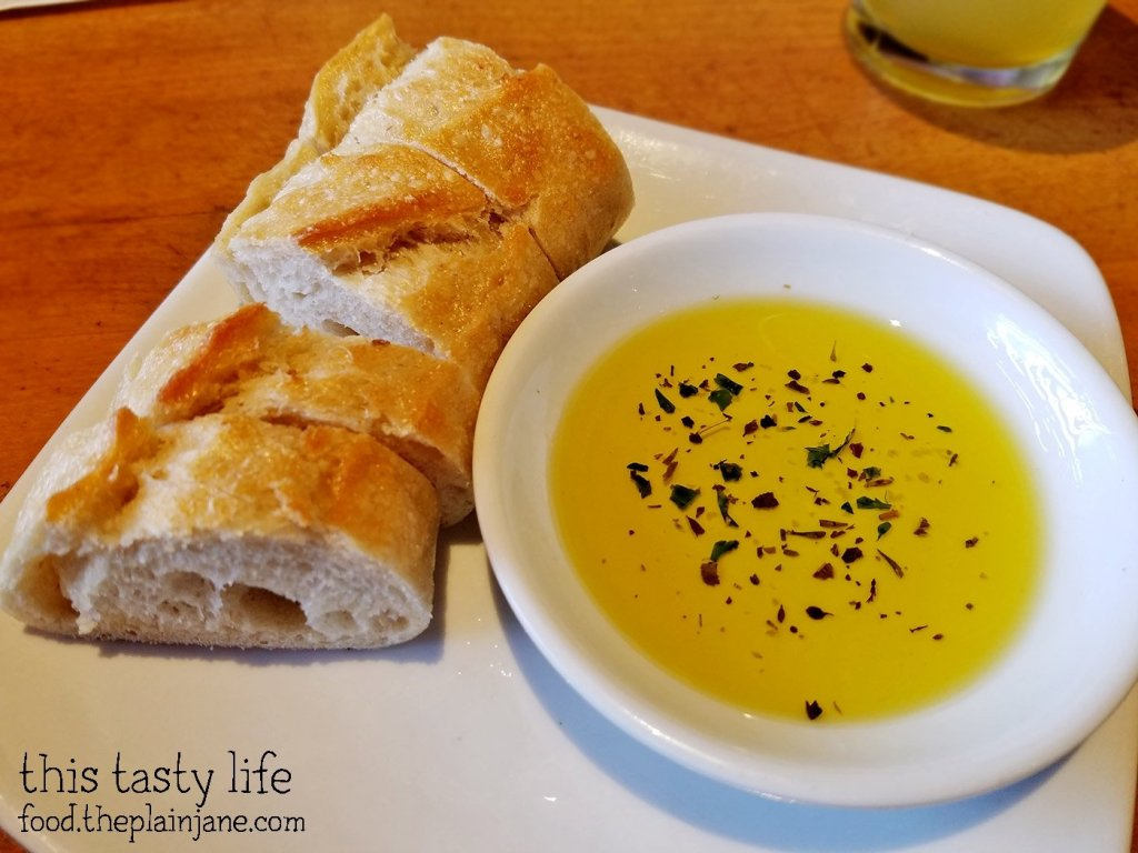 Complimentary bread and olive at California Pizza Kitchen