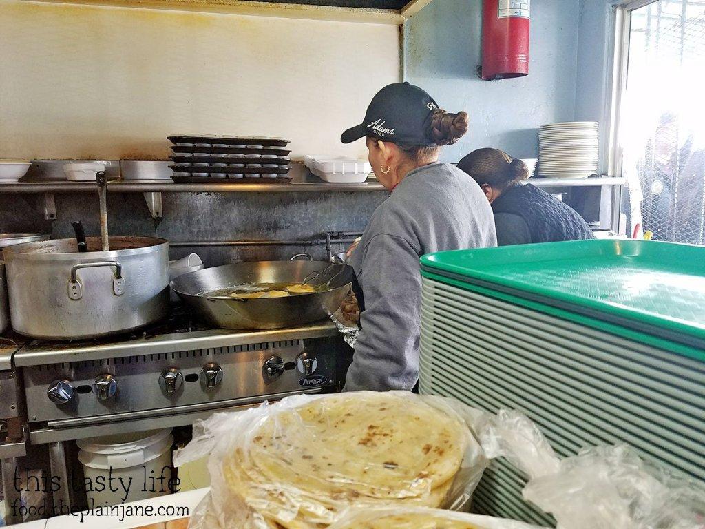 Ladies making fresh tacos at Las Cuatro Milpas | San Diego, CA | This Tasty Life