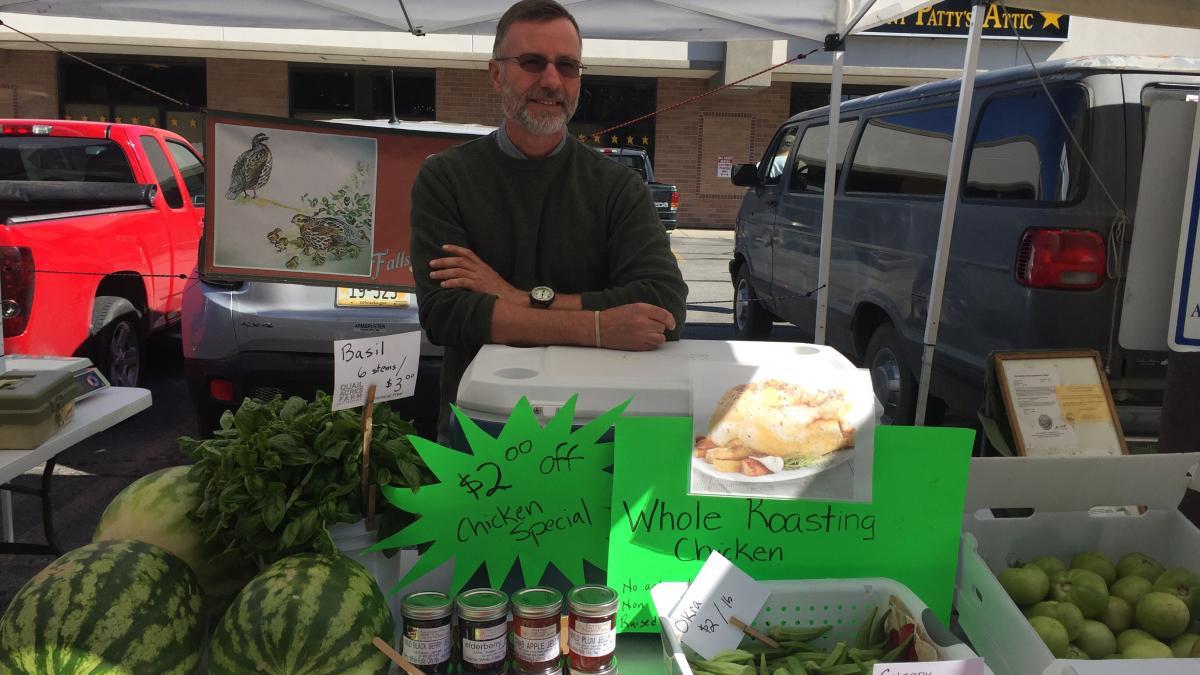 vendor at farmers market