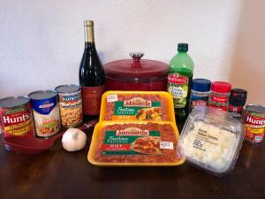 Italian Chili Ingredients including: Italian hot sausage, Italian mild sausage, Cannellini white kidney beans, dry red wine, fire roasted diced tomatoes, diced white or yellow onion, chopped garlic cloves, tomato paste, chicken broth, crushed red pepper, sea salt, and pepper.