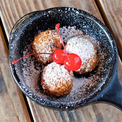Torchy's Tacos Lil' Nookies are FRIED CHOCOLATE CHIP COOKIE DOUGH DUSTED WITH POWDERED SUGAR & TOPPED WITH CHERRIES.