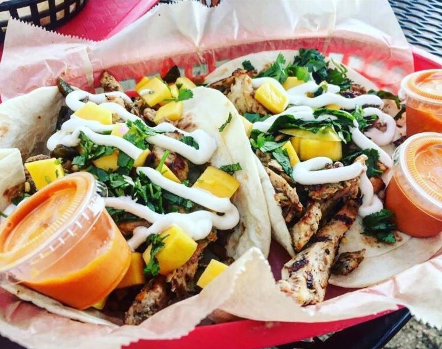 Torch's Tacos Brushfire Taco made with JAMAICAN JERK CHICKEN, GRILLED JALAPEÑOS, MANGO, SOUR CREAM & CILANTRO WITH DIABLO SAUCE ON A FLOUR TORTILLA.