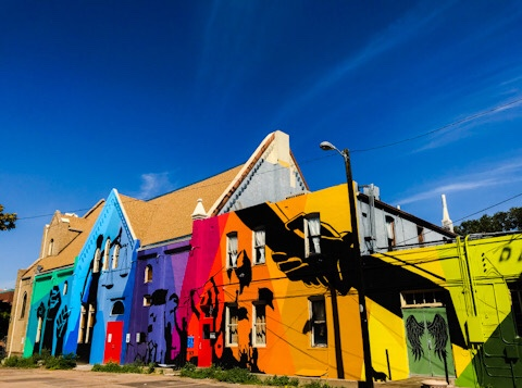 The Denver Curious Theatre Company is located behind Torchy's Tacos on Broadway in Denver, CO.  The building has wonderful street art painted on the walls in rainbow colors and butterflies.