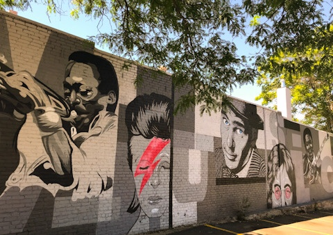In the parking lot of Torchy's Tacos on Broadway in Denver, CO is an amazing mural paying homage to iconic musical artists.