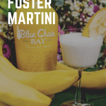 A bottle of Blue Chair Bay Bananas Rum Cream, fresh bunch of bananas, and a Bananas Foster Martini surrounded by fresh flowers.