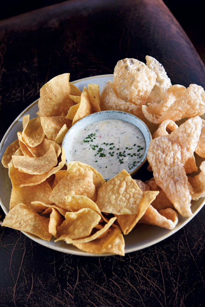 """In homage to the lontime previous occupant, KTs """"famous"""" spinach queso is on the menu, but with a Le Moo twist — pork rinds"""