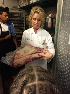 Chef Lee Ann Whippen with a hunk of Wagyu beef
