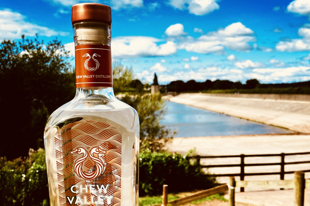 Bottle of Chew Valley gin at reservoir