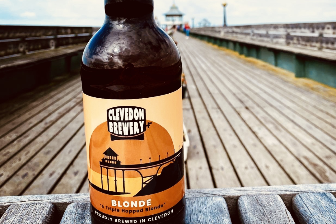 Bottle of Clevedon Brewery's ale on the pier