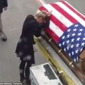 Grieving widow meets her hero Green Beret husband's coffin on the airport tarmac - leaving scores of plane passengers in tears