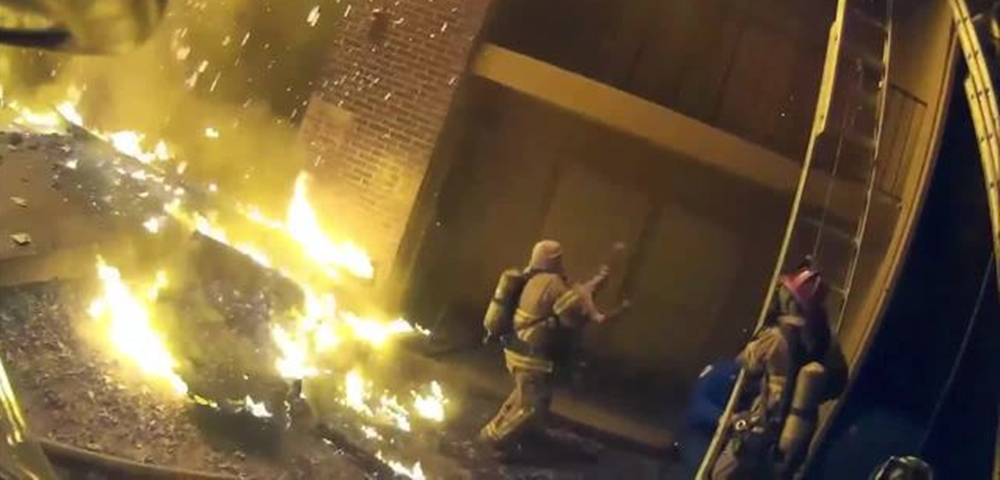Firefighter catches child tossed from burning building