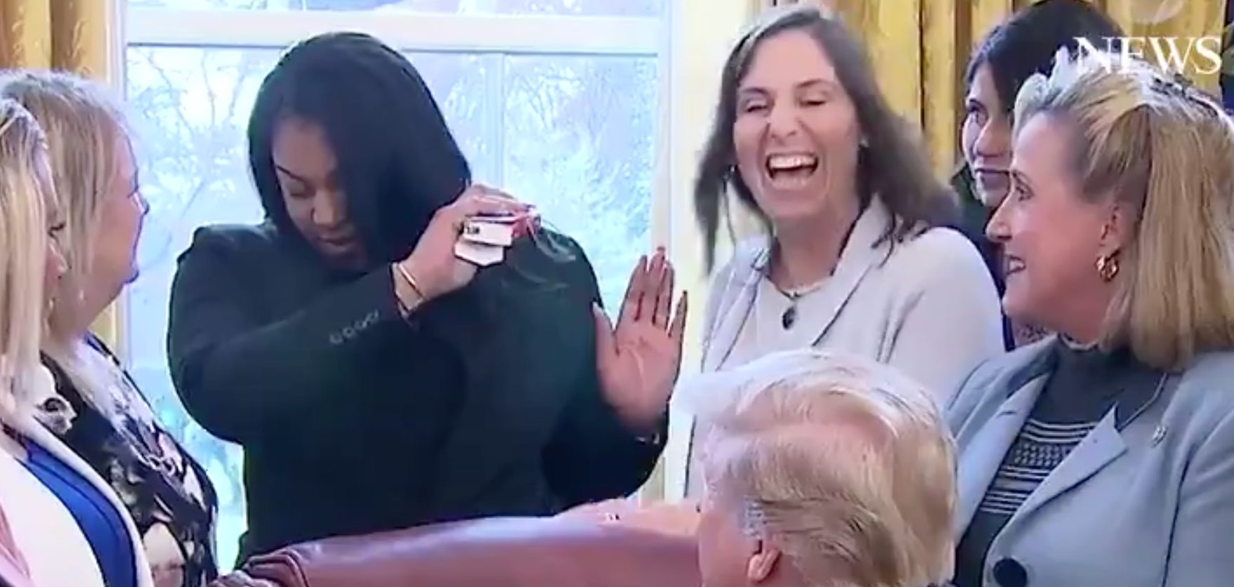 A woman dabbed as President Trump signed a bill against online sex trafficking in the Oval Office on Wednesday.