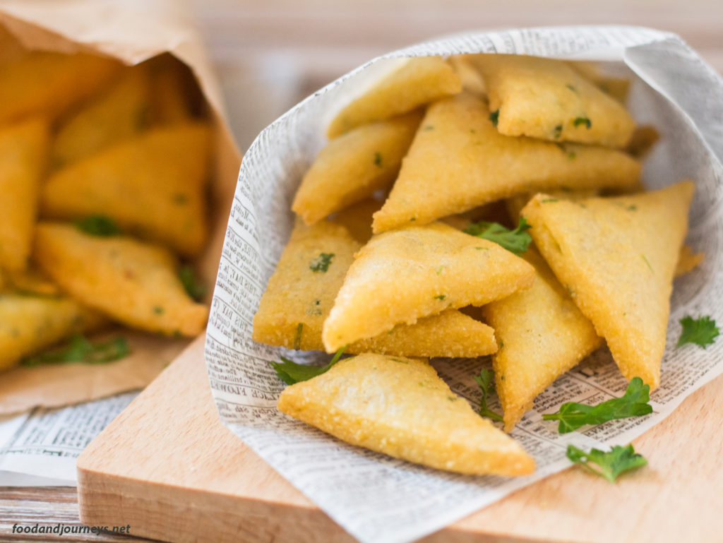 Panelle (Sicilian Chickpea Fritters) served on a paper, typical serving for street food.