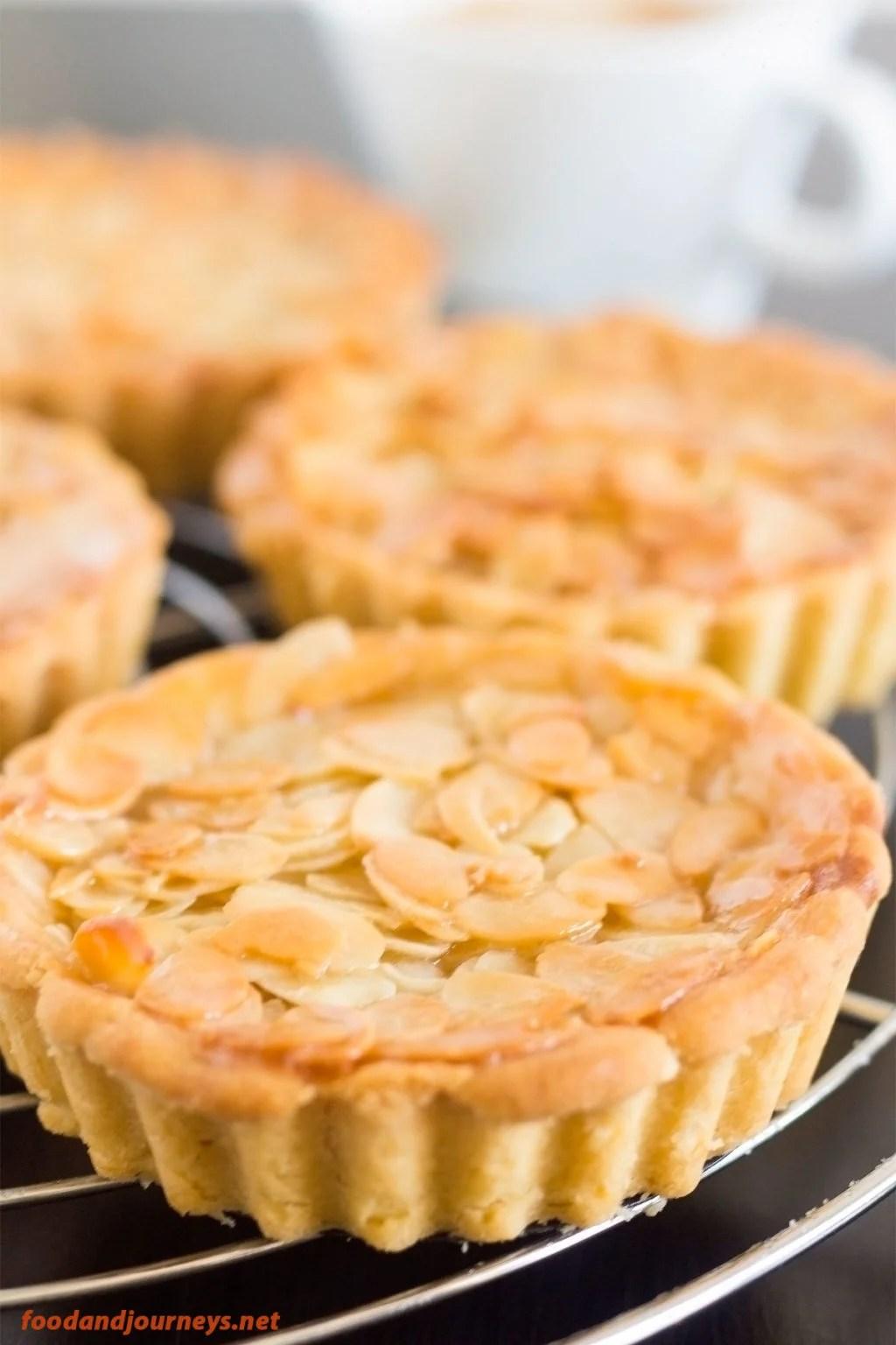 Closer shot of Swedish Almond Tart, highlighting the almond bits on top.