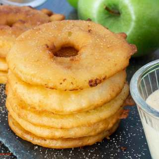 Stack of German Apple Fritters, sprinkled with cinnamon-sugar, and with Vanilla Sauce on the side