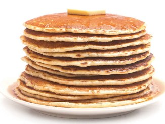 A plate of pancakes with butter on top