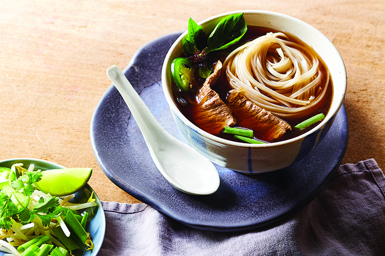 Easy Beef Pho surved in a bowl on a countertop