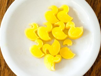duck-shaped ice cubes made from 100 percent orange juice on a white plate