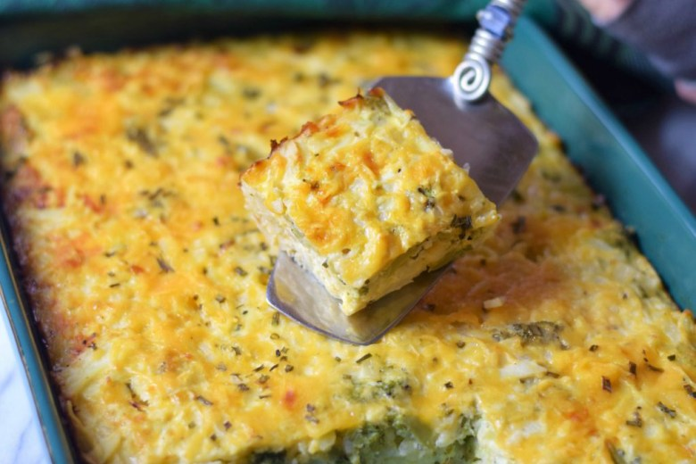 Hash Brown Casserole with Veggies in pan and on spatula, ready to be served