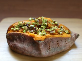 Baked sweet potato topped with honey-pistachio mixture
