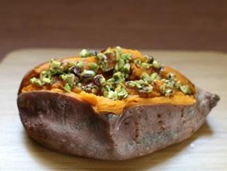 Baked sweet potato topped with honey-pistachio mixture