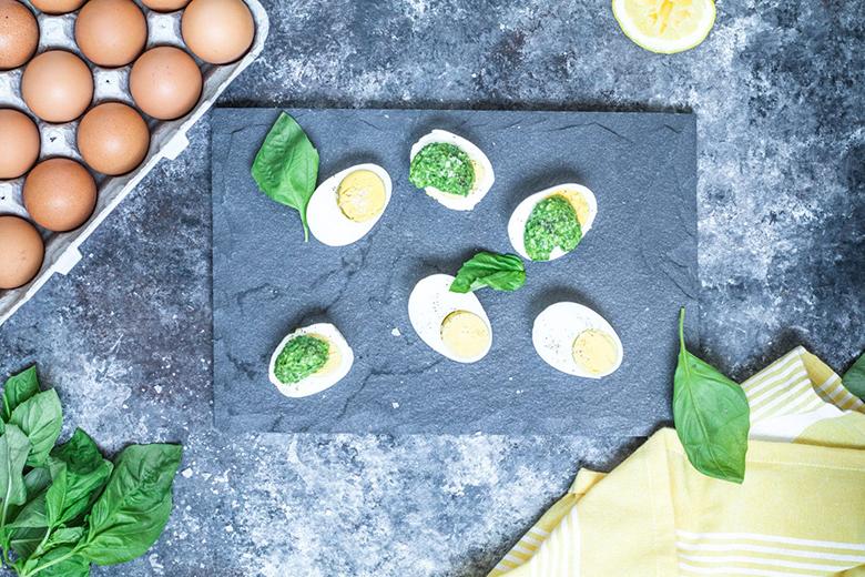 Parmesan Pesto Over Eggs on a slate serving board
