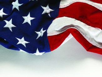 Portion of an American flag that appears to be waving