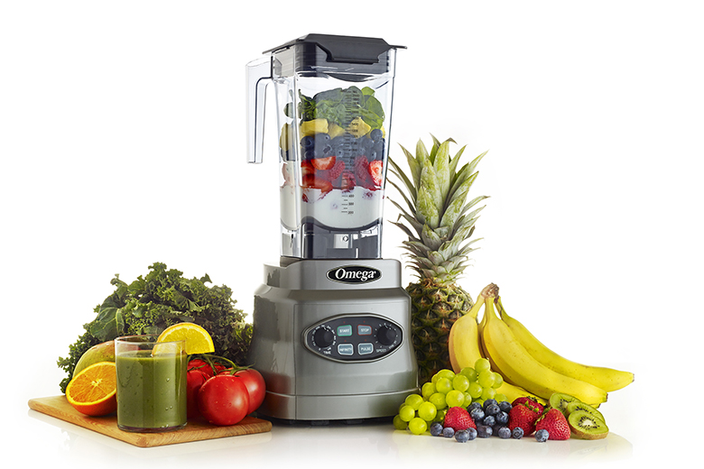Omega OM7560S 3HP Blender surrounded by fruit and veggies