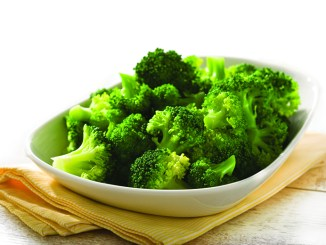 boiled broccoli in white bowl on table