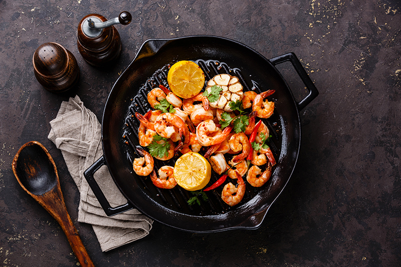 Prawns Shrimps roasted on frying grill pan