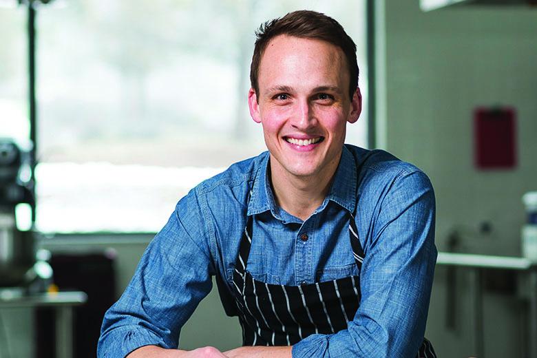 Picture of Garrett Berdan, sitting down in an apron