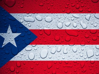 Illustrative editorial of Puerto Rico flag and rain drops