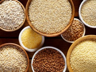 A variety of whole grains in different size bowls