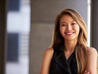Young Asian woman smiling and confidently looking at camera