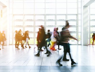 abstract blurred business people rushing on a floor