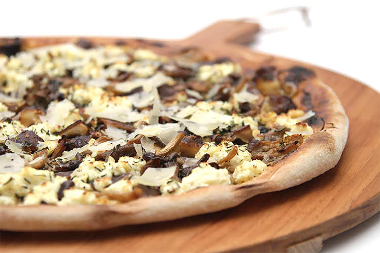 Mushroom pizza with ricotta and garlic confit spread