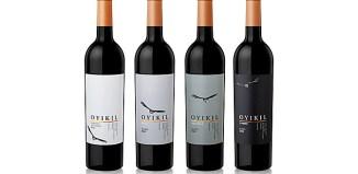 four bottles showing wine labeling