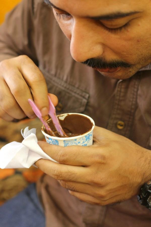 Jagan eating hot chocolate