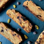 Vegan trail mix biscotti cookies include dried cranberries, pistachios, walnuts, and chocolate chips
