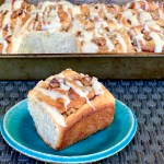 Vegan banana bread cinnamon rolls with walnuts and cream cheese icing