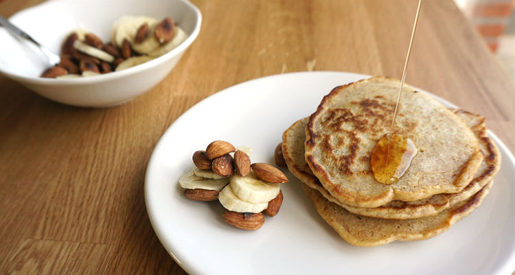 Oatly milk pancakes with almonds banana and maple syrup