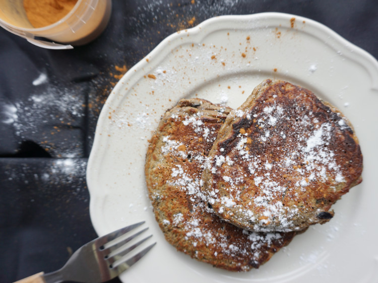 carrot cake pancakes with icing sugar and cinnamon