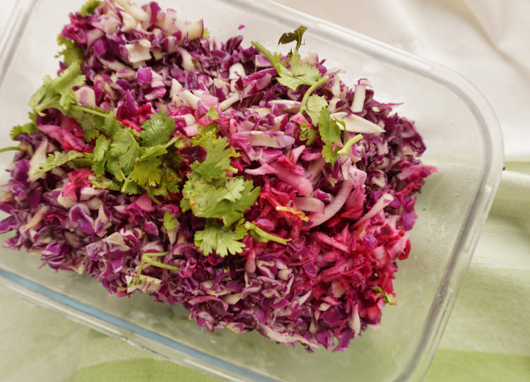 sliced red cabbage with some lime juice making it pink instead of purple