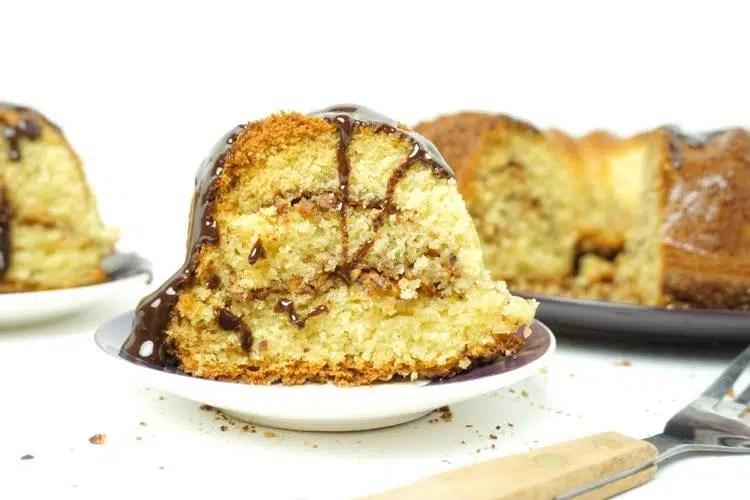 slice of hazelnut crumble bundt cake with sour cream