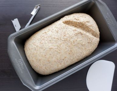 bread shaped in a pan started the carving